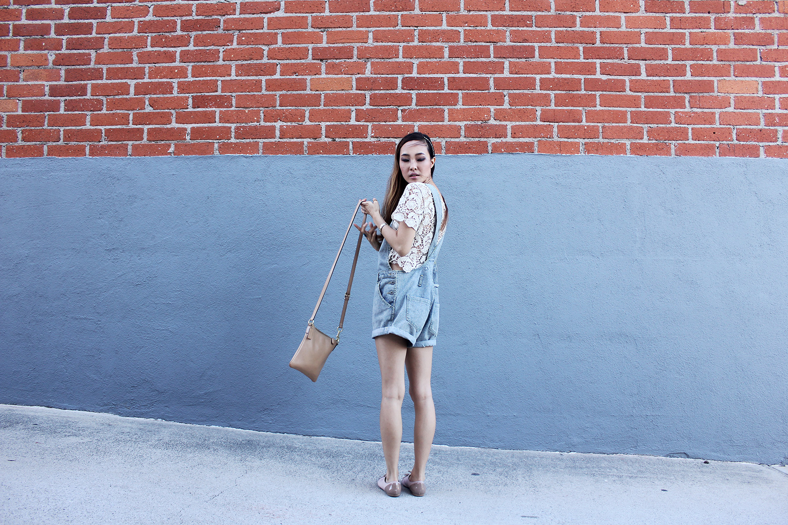 A neutral crossbody Coach bag that's perfect for everyday outings.