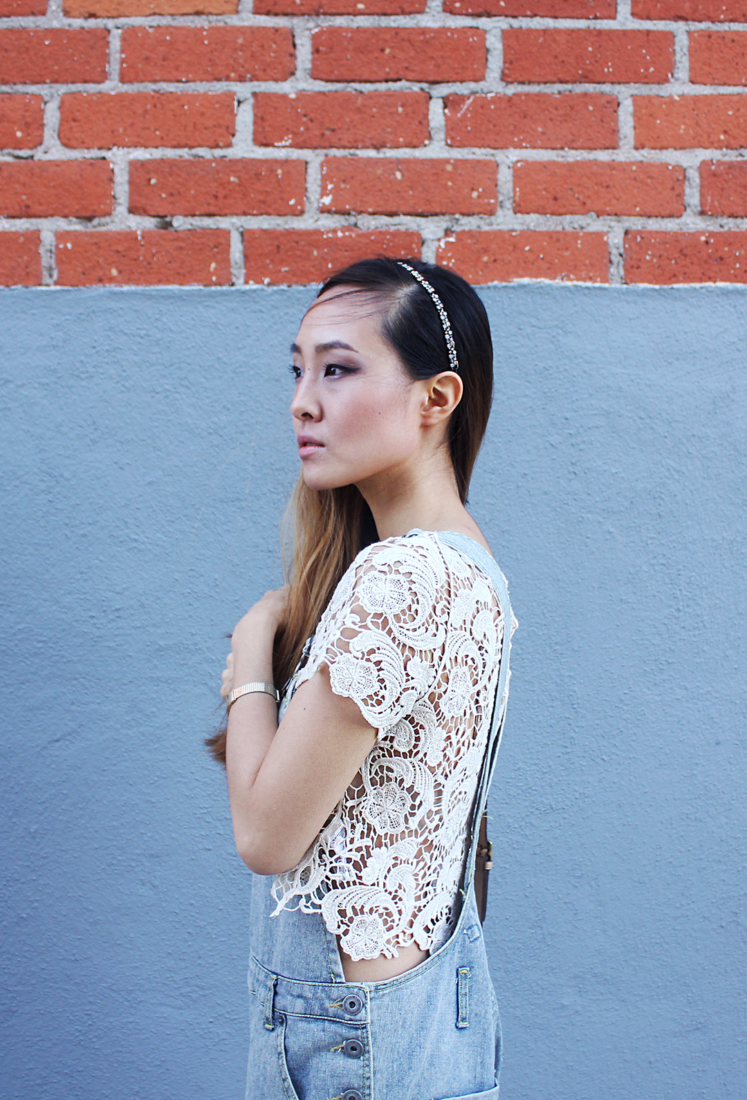 Lace crop top brings a feminine element to the entire look