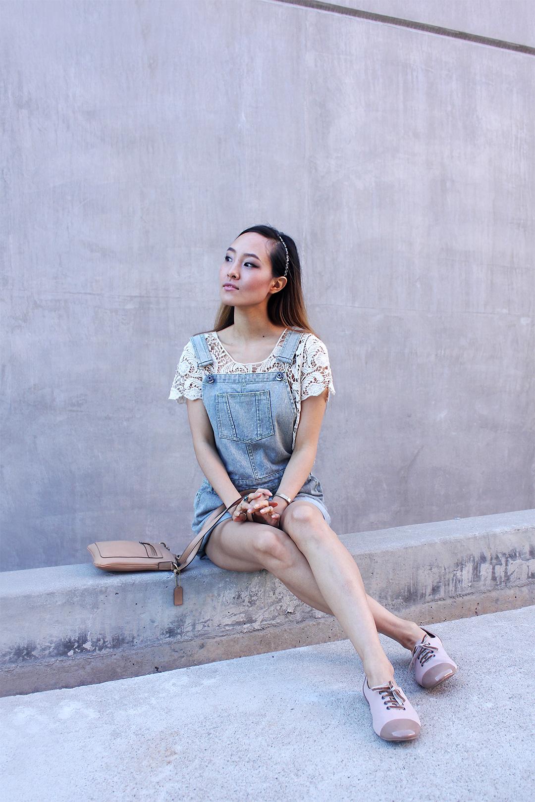 A feminine take on denim overalls