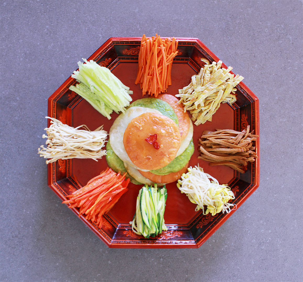 The Gujeolpan is one of the most colorful and beautiful of Korean dishes. It is made up of nine different ingredients, including flour pancake wraps (jeon) and thinly sliced vegetables and meat.