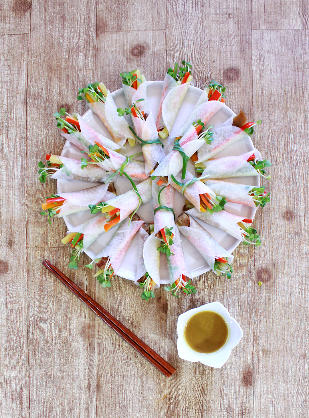 A vegetarian take on the Korean Ssam Mu (Radish Wrap) dish! Dip it into the spicy mustard sauce for an extra kick!