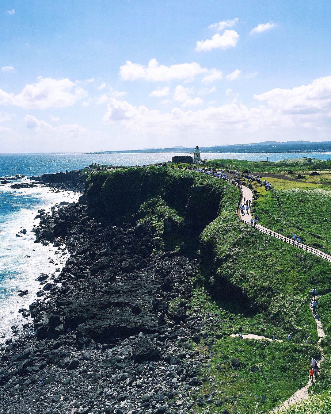 A scenic trail leading to a light house