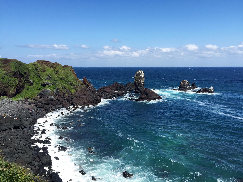 Beautiful emerald beaches and black lava rock