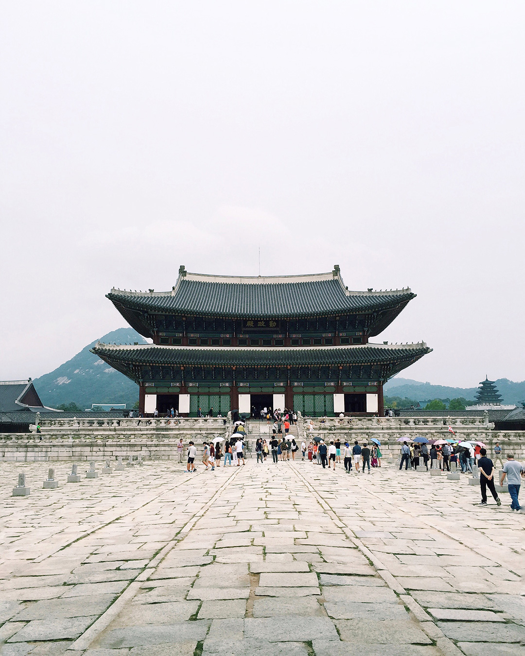 Geunjeongjun is the main throne hall where state affairs were held. The raised portion of the cobblestone path in the center is exactly as wide as the king's palanquin that carried him around as he was not allowed to walk on common ground by law.
