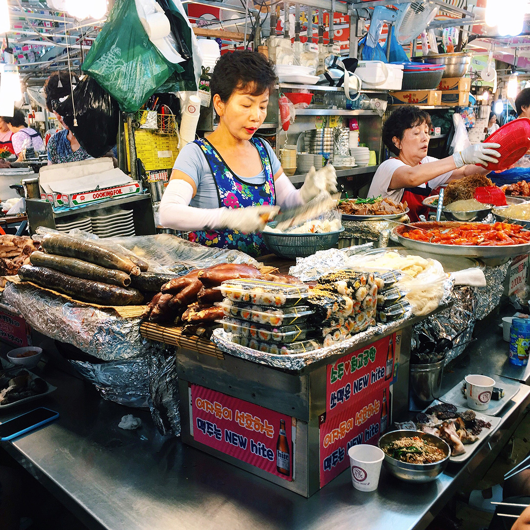 This ajumma is selling soondae, pork trotters, mayak kimbab, ddukbokki, and much more.
