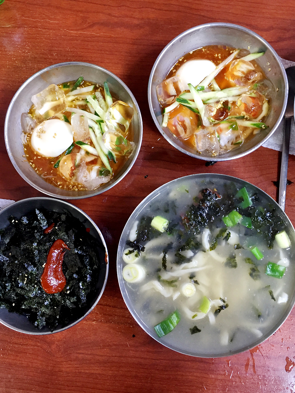 Han Soon Ja Kal Guksu (한순자 칼국수)  Info: The menu is insane here! 4,000 won for three things, including kalguksu (knife-cut noodles), boribab (barley rice), and naengmyun. What a steal! Address: 48-12 Namchang-dong, Jung-gu, Seoul, South Korea   남대문시장 · 서울시 중구 남창동 48-12   Website