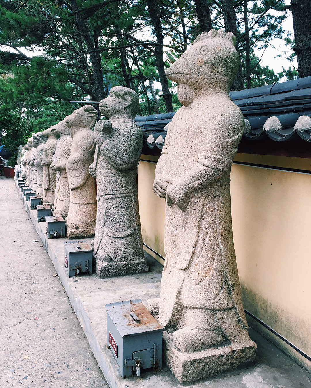 Chinese Zodiac sculptures line the entry to the temple.
