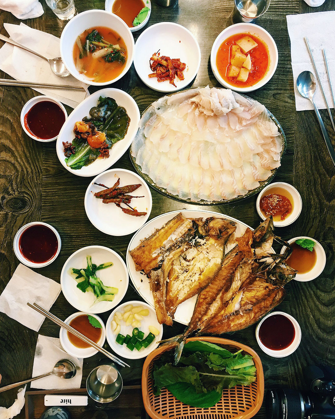 Korean style sashimi, fried fish, and banchan from the Jagalchi Fish Market.