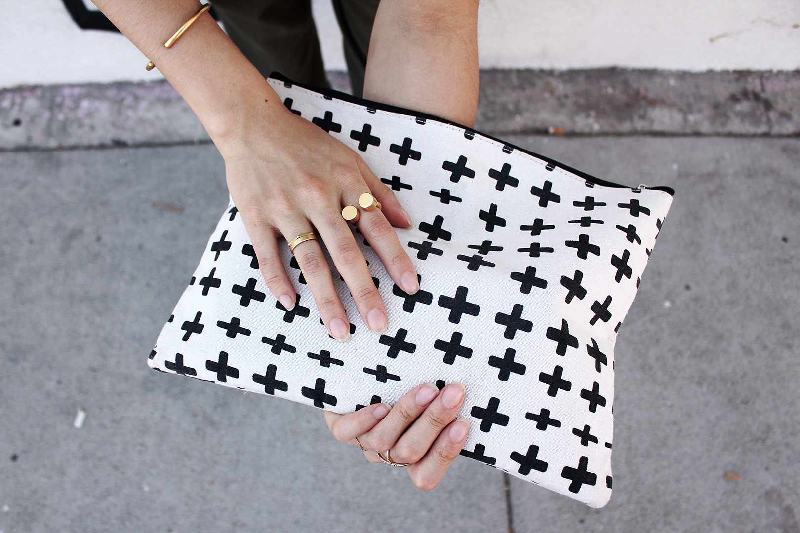 Cuff bracelet and cosmicplay open ring from Madewell, cross pattern clutch from Butter, cross ring from Kavano