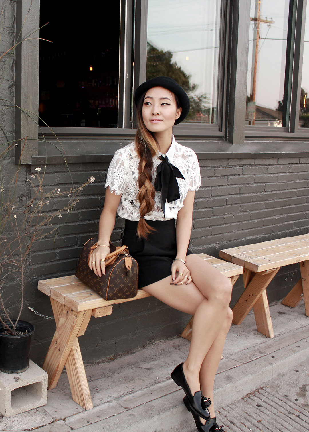 Nasty Gal lace blouse, Urban Outfitters hat, Zara high-waisted shorts, Zara loafers, and Louis Vuitton Speedy bag
