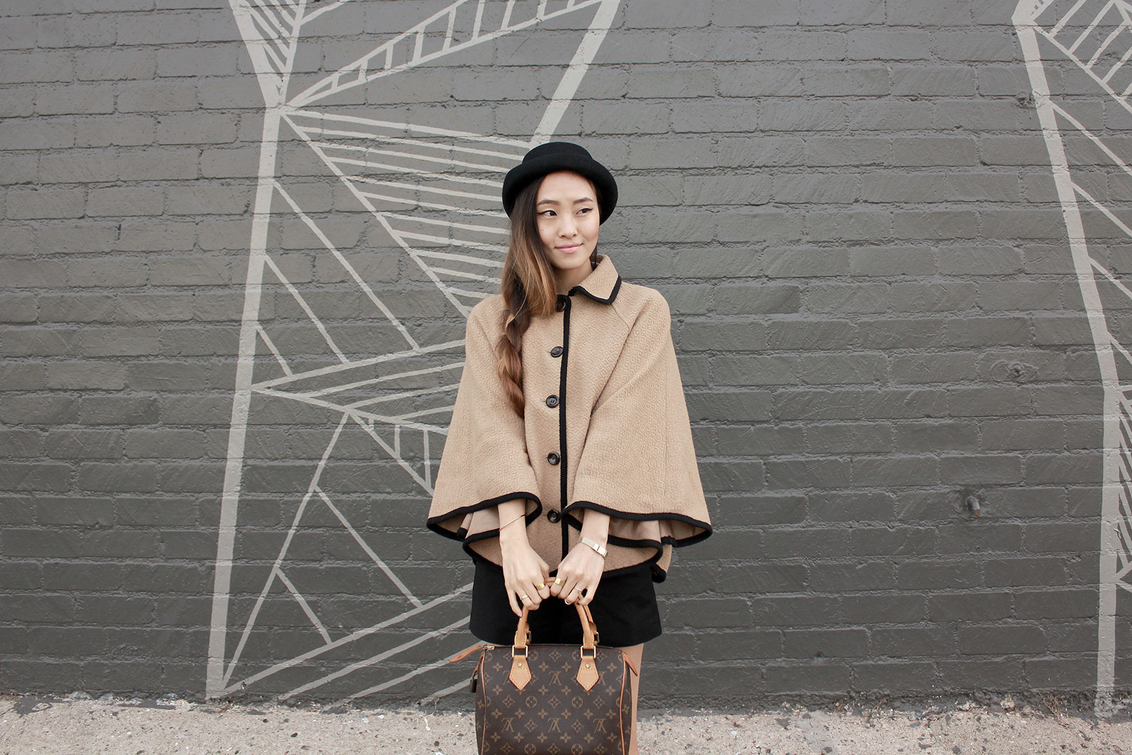 Forever 21 cape coat, Urban Outfitters hat,  Zara high-waisted shorts, Zara loafers, and Louis Vuitton speedy bag