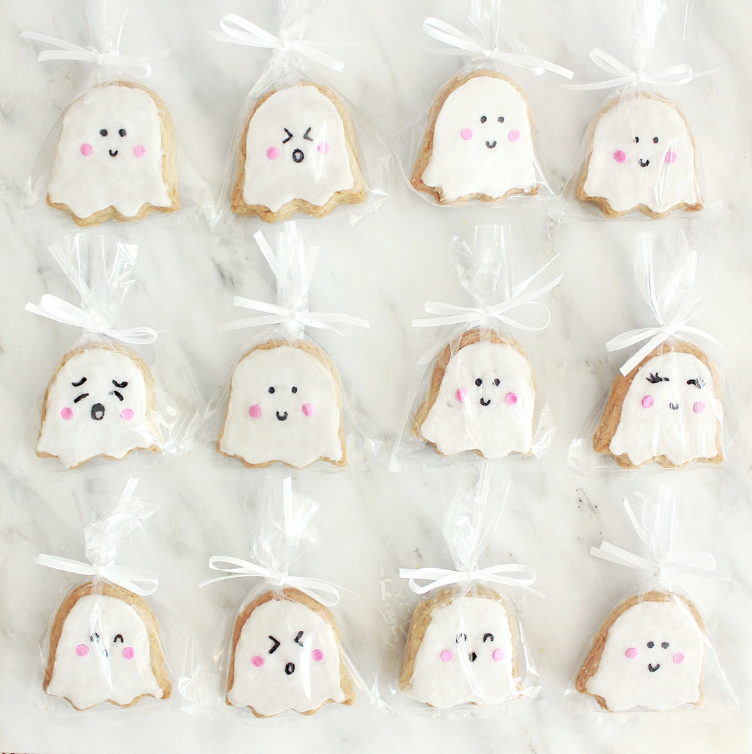 STEP 5 (Optional) - Place a single cookie into each treat bag and tie with a zip tie and a satin ribbon.Place your finished party favors on a pretty tray and let your guests enjoy them!