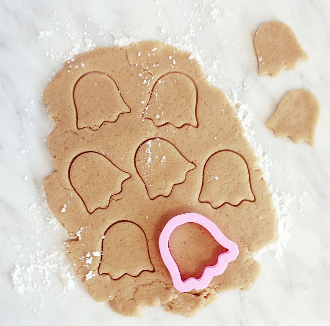 STEP 1 - Either make a simple sugar cookie dough (recipe here), or buy cookie dough from your nearest grocery.Preheat oven to 350 degrees.Roll out the cookie dough and cut out your cookies with your ghost shaped cookie cutter. You can make roughly 40 cookies with this cookie cutter.Set your cookies on a baking sheet with parchment paper, and bake for 8-12 minutes, until the edges just start to turn golden brown.Let your cookies cool down.