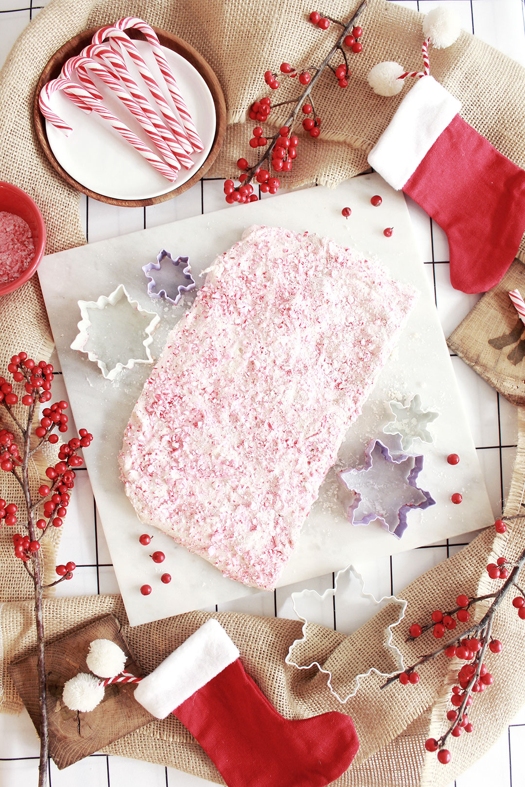 STEP 1 - To create the marshmallows:Grease the baking sheet and generously dust powdered sugar over the top. Set aside.In a mixing bowl, sprinkle the gelatin powder packets over 1/3 cups of water. Let it soften, and set aside.In a medium saucepan, combine 1/3 cups water, 1 cup granulated sugar, 1 cup light corn syrup, and 1/4 teaspoon salt. Bring to a boil over medium-high heat for about a minute, and then turn off.Take the saucepan mixture and slowly pour into the mixing bowl with gelatin while blending on the lowest speed. Slowly increase the speed to high for about ten minutes. The mixture should go from clear to white, and get increasingly thick and sticky.Add 1 teaspoon of peppermint extract and mix for another minute.Randomly add drops of red food coloring and mix just a few times to create red swirls throughout the marshmallow mix.Wet your hands to minimize sticking, and pour the mix into the baking sheet, creating a rectangular shape.Sprinkle the crushed candy canes all over the top of the marshmallow.Set aside pan for at least two hours.