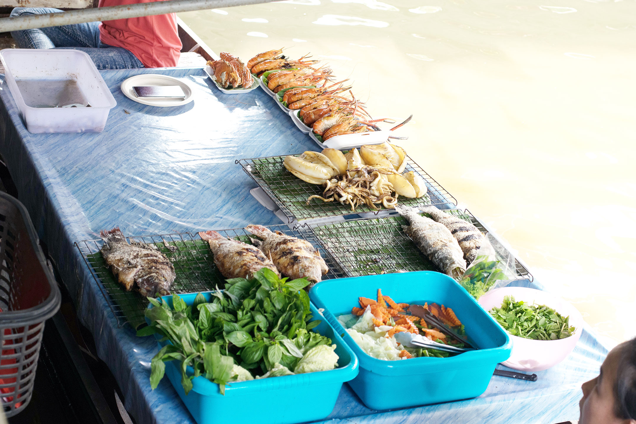 Freshly roasted seafood and ingredients by the river.