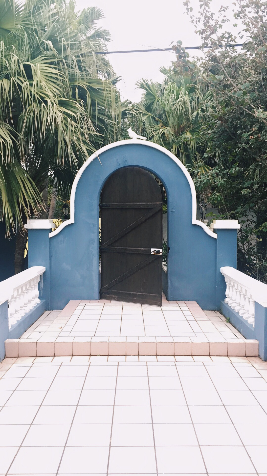 The pastel blue entryway to our Airbnb!