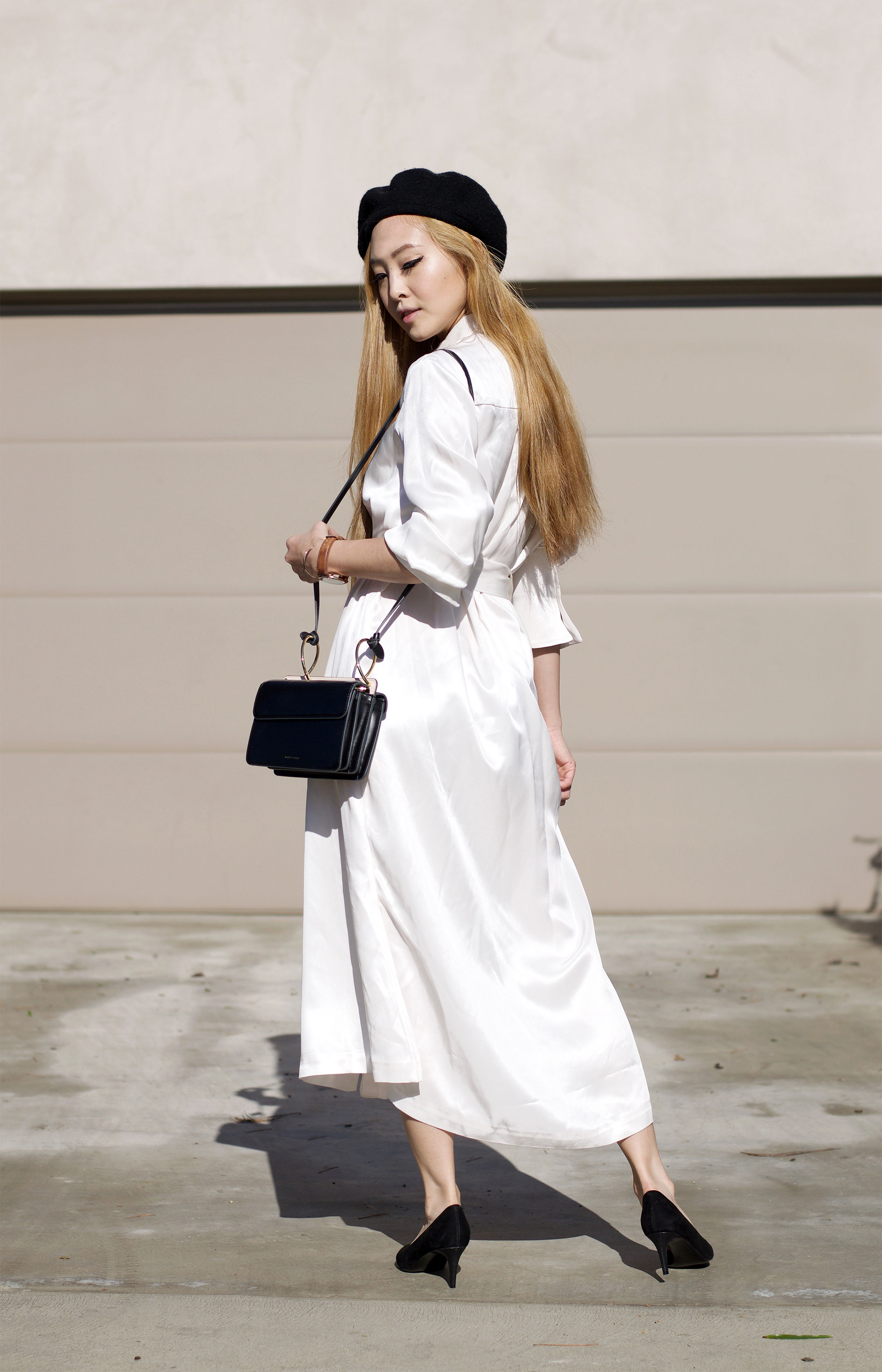 Today I wanted to share with you the perfect shirt dress for spring. A white button up is such a classic and timeless piece, that it makes sense to turn the flattering silhouette into a dress. | SPRING FASHION | SPRING OUTFIT | MAXI DRESS | SATIN DRESS | WHITE SHIRT DRESS | LONG DRESS WITH SLIT | BERET | KITTEN HEELS |