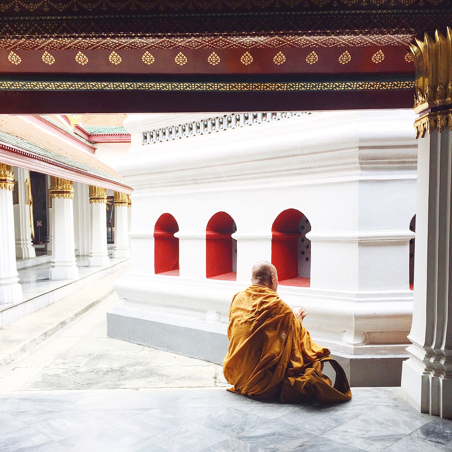 Old and new collide as this monk dressed in traditional Buddhist robes spends time on his iPhone.