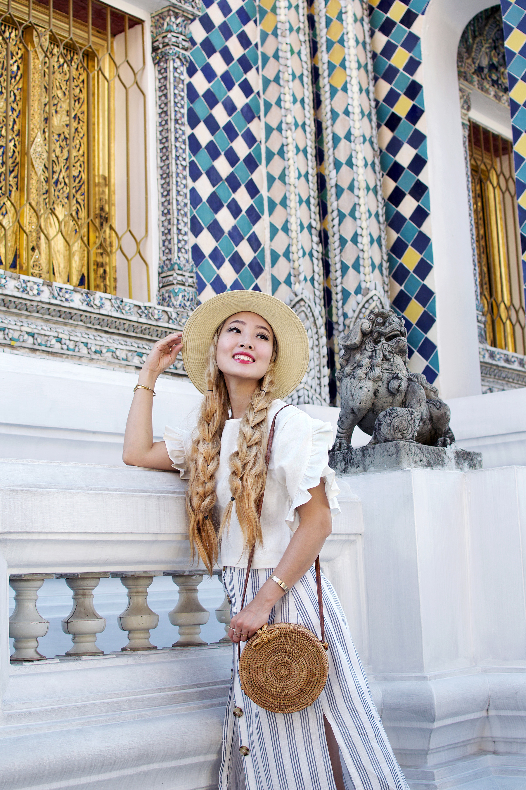 I'm kicking off my #Thailand travel content at the gorgeous Temple of the Emerald Buddha, known locally as Wat Phra Kaew. For all architecture and history lovers, this is a must see. Check out the post to see my travel outfit, amazing architectural views of Wat Phra Kaew, my new favorite Thai fashion brand, as well as tips on visiting, including the dress code, etiquette, and entrance fees! | #ontheblog | #ootd | #travelThailand | #traveloutfit | #WatPhraKaew | #Bangkok | #visitThailand | #travelguide | #thingstodo