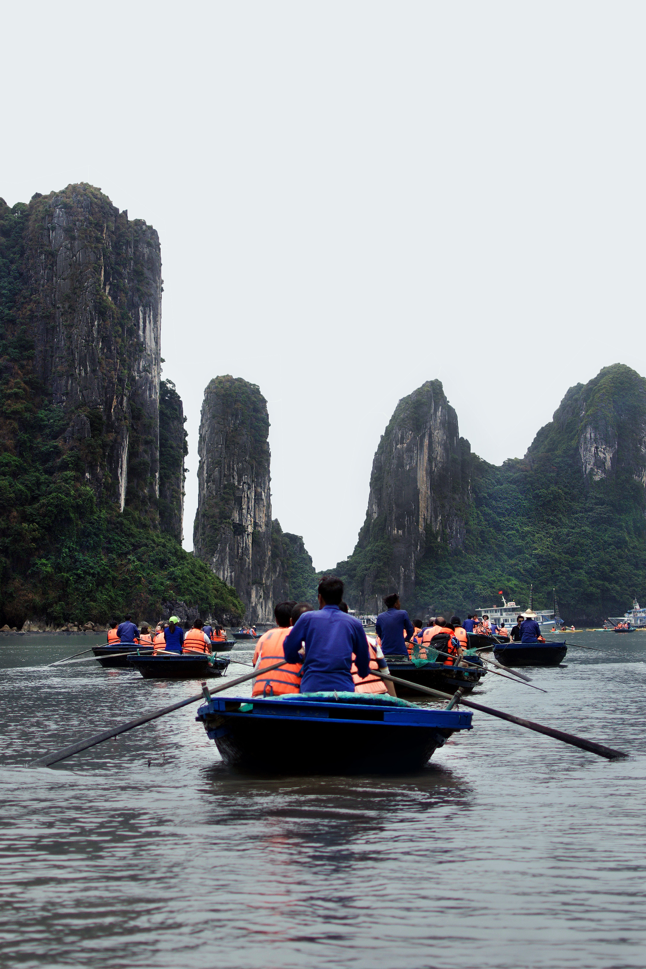 KAYAKING TO THE GROTTOES One of our Ha Long Bay tour activities included going on bamboo boats and riding through the natural grottoes in the limestone islets.! Ha Long Bay is truly otherworldly.