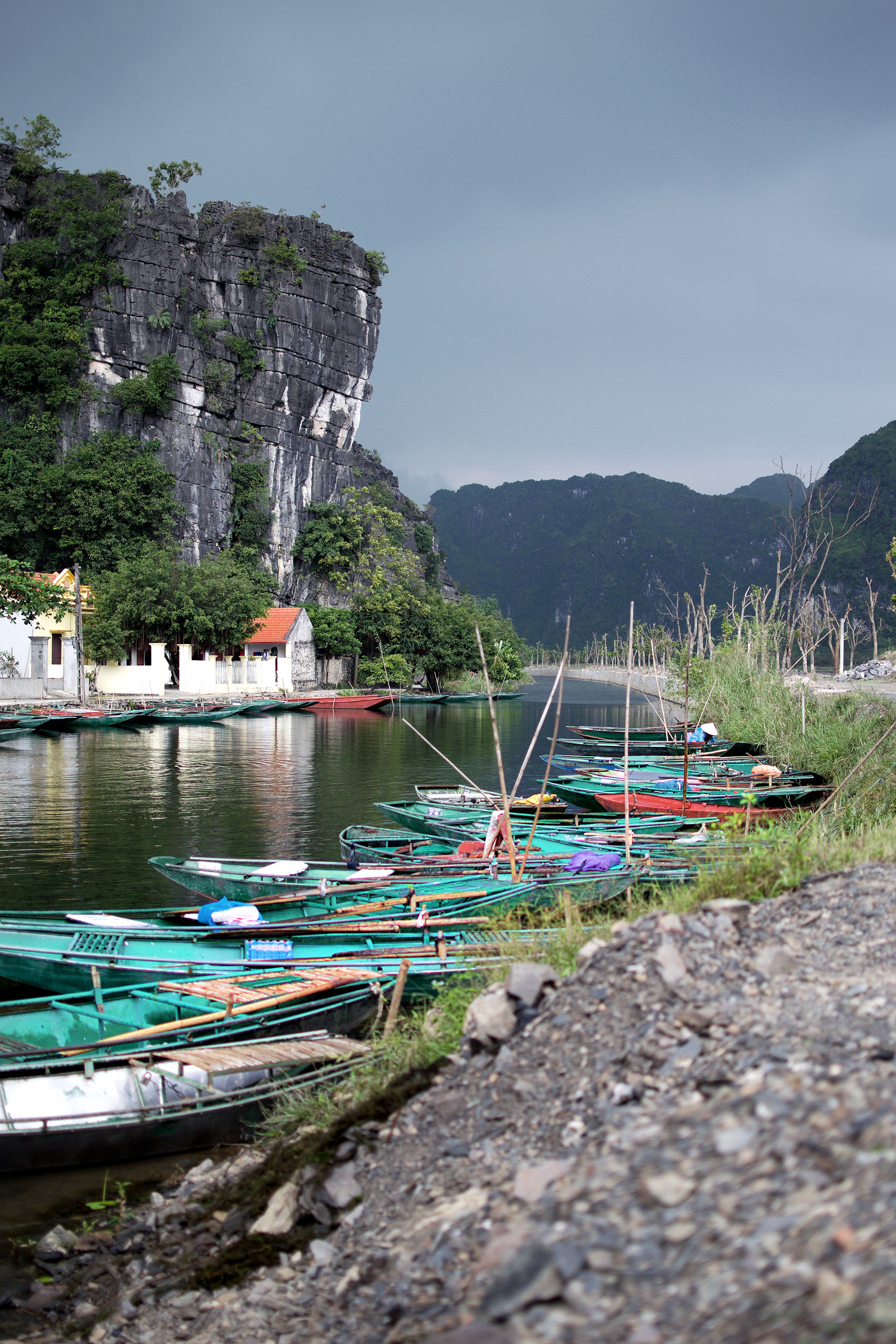 COLORFUL BOATS DOCKED IN THE COUNTRYSIDE IN NINH BINH