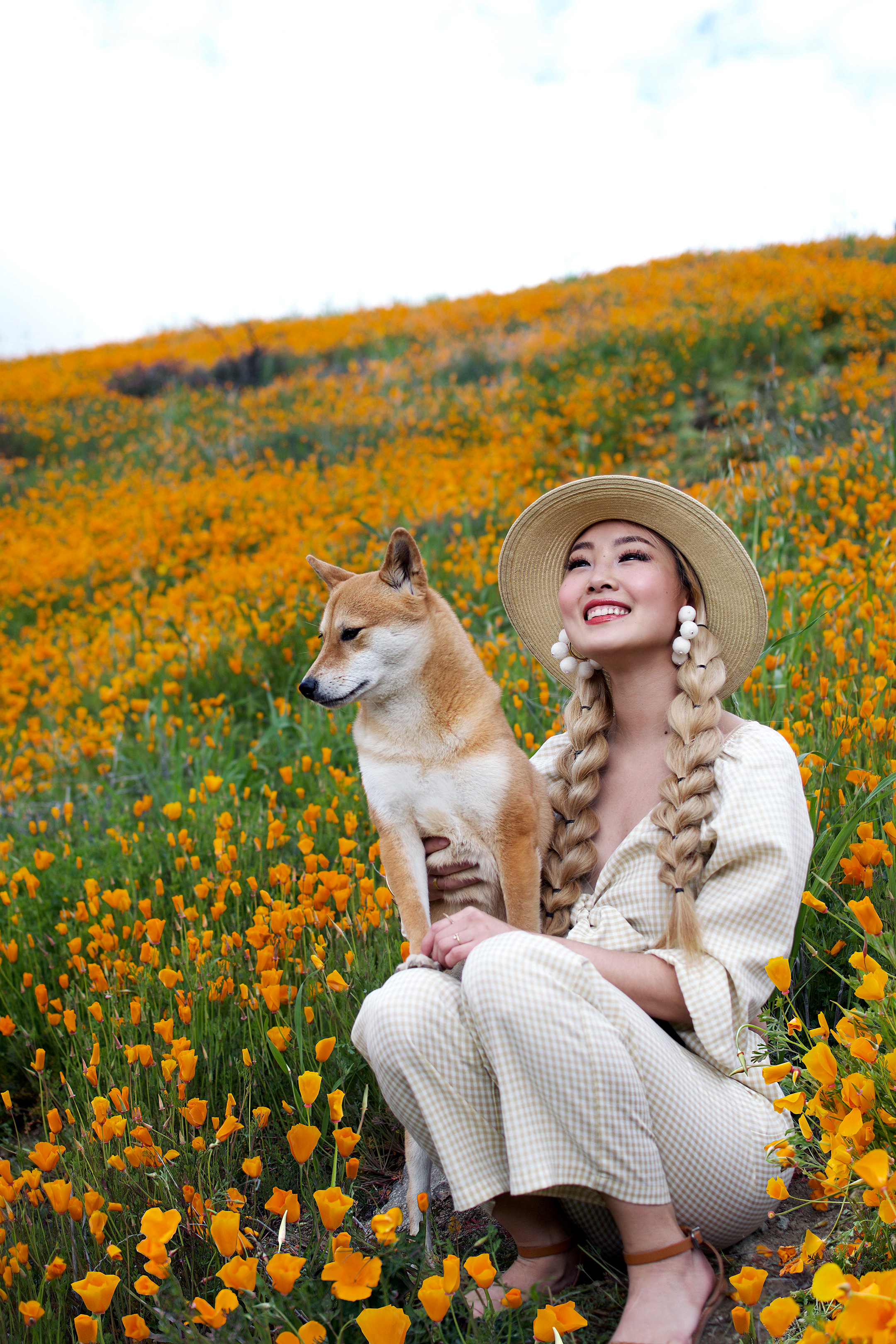 Happy spring! LA had the coldest and wettest winter I've experienced in years, but thanks to all the rain nature gifted us with a sea of blossoms all over Southern California! This year I got to enjoy the wildflower super bloom at  Walker Canyon Poppy Fields , where the mountains were gloriously ablaze in a blanket of orange blooms! #springoutfit #walkercanyonpoppyfields #superbloom #springfashion #ginghamfashion