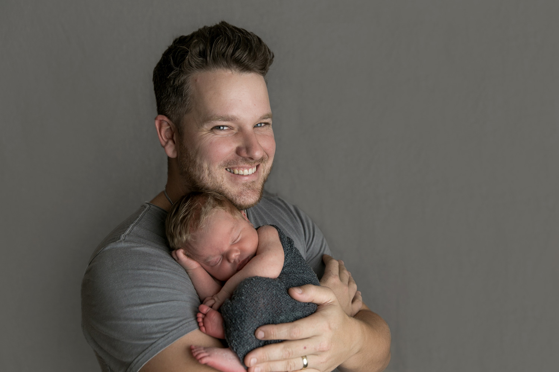 dad and baby neutral grey newborn family photos gold coast jade read photography