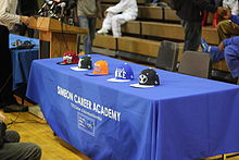 220px-20121220_Jabari_Parker_verbal_commitment_press_conference_team_hats.JPG