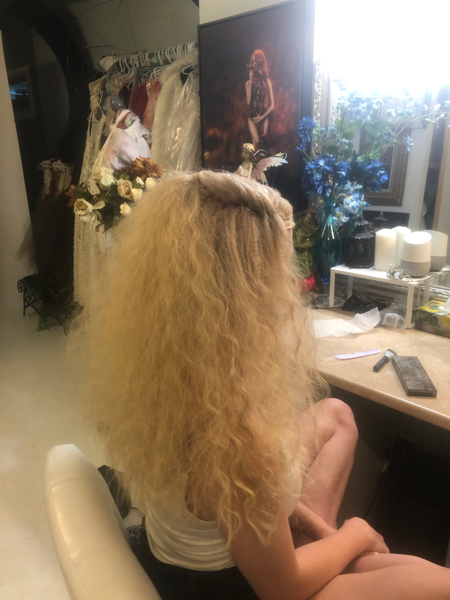 I achieved the fluffiness by using a micro crimper on her root area, and a larger crimper for the length.