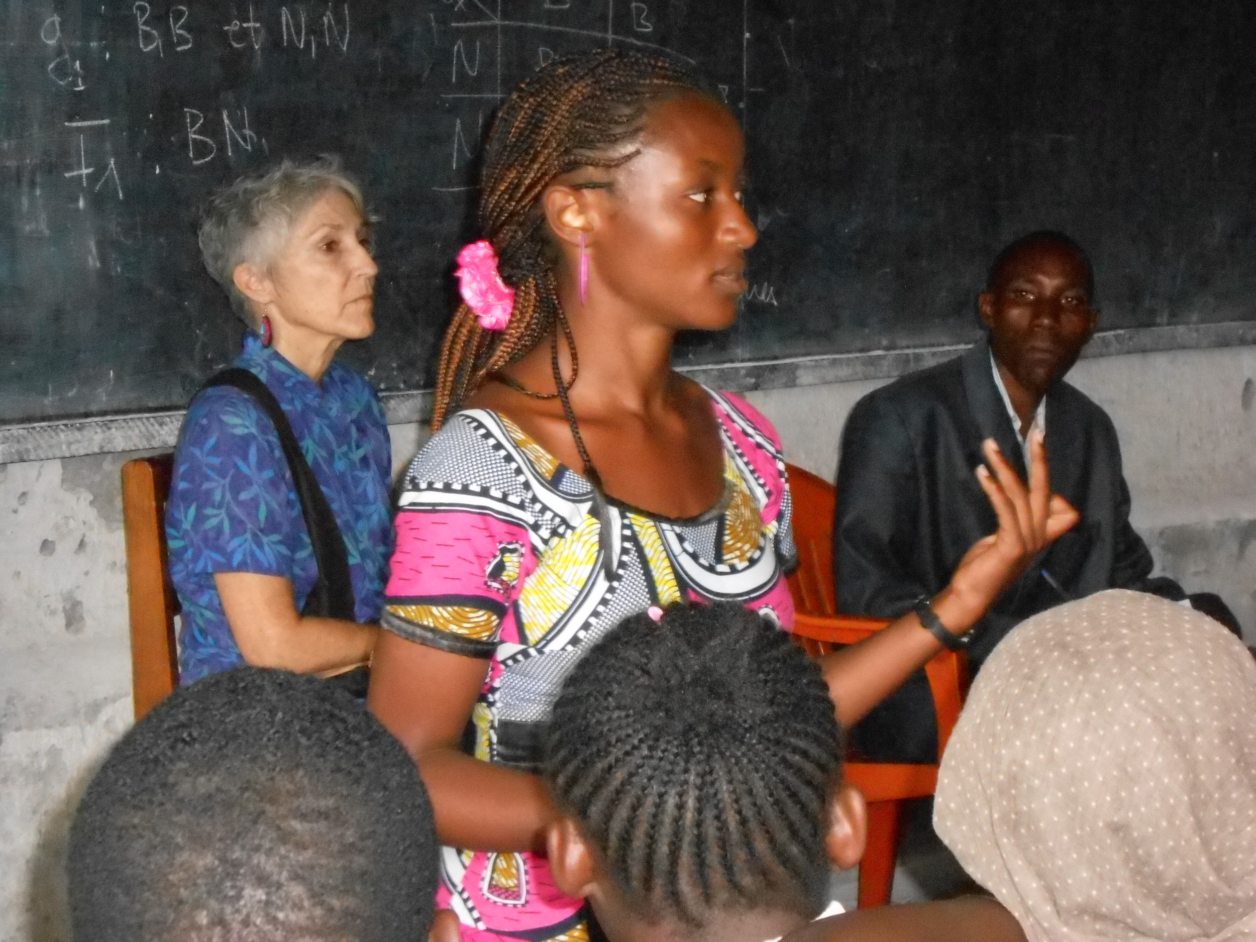 ACT for Congo's Executive Director Judy Anderson watches Peer Educators lead a reproductive health seminar at the local high school in Goma, DR Congo.