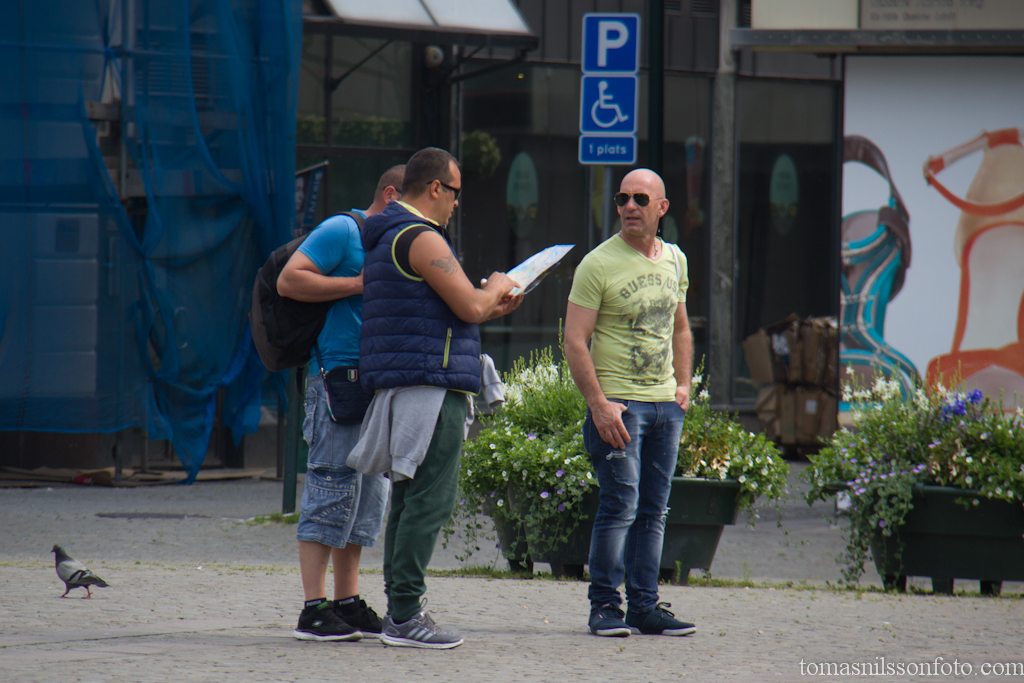 Visitors from Italy trying to find their location on their map.