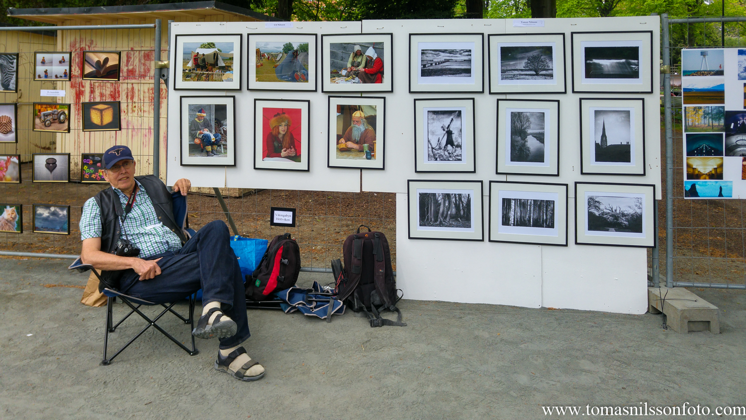 My dad in front of his six frames from the Viking Market on the left, my nine black and white frames on the right