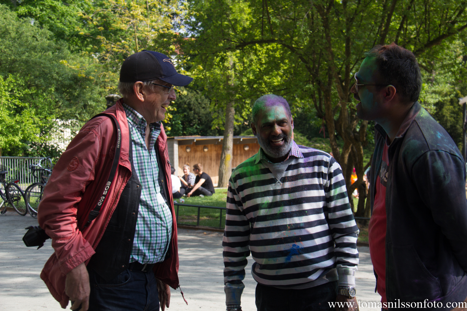 My dad speaking to two of the people who had taken part in the Holi celebrations held in a different part of the park.