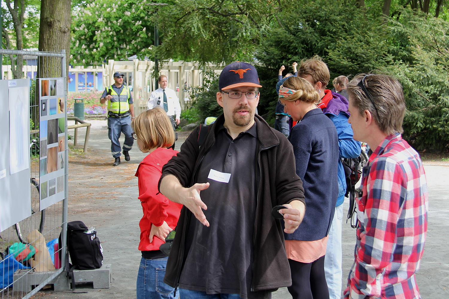 """One of the """"downsides"""" to being at a photo exhibition. You run the risk of ending up in a picture! Here I'm gesturing about something with Klas Svensson, a fellow exhibitor who showed some very fine nature photographs. Photo by Ulf Nilsson"""