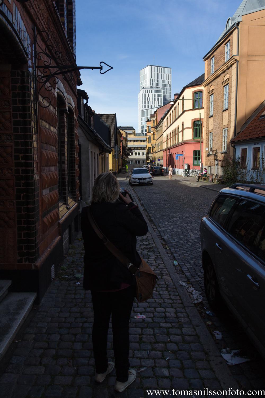 Susanne lining up a shot of Malmö Live.