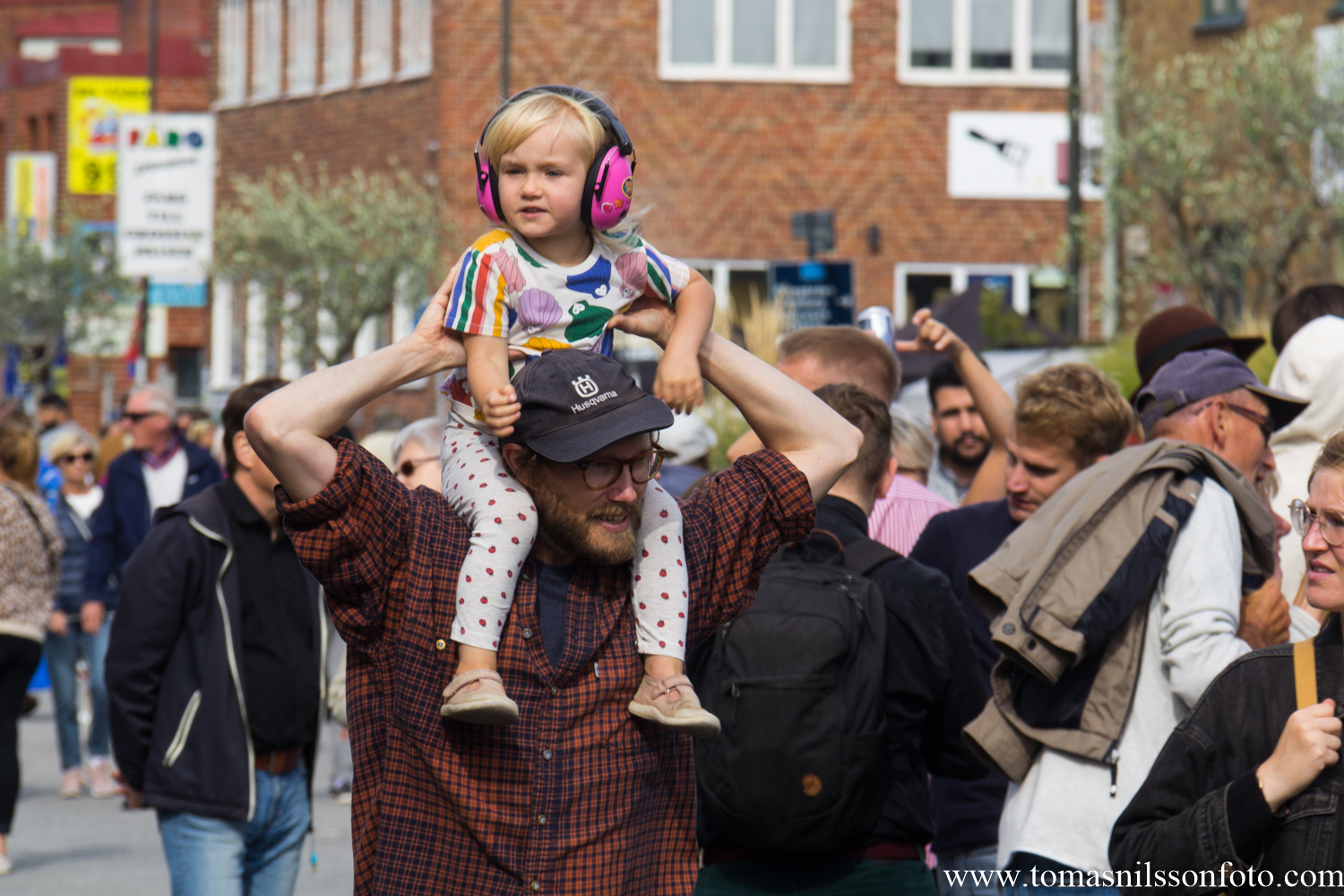 Good thing this kid's ears (like many others her age) are safe at the festival!