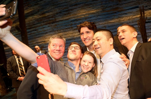 Canadian Prime Minister Justin Trudeau poses for a selfie with the crew backstage at the hit musical 'Come From Away' on Broadway at the Schoenfeld Theatre on March 15, 2017, in New York City. CREDIT - Bruce Glikas/Getty Images