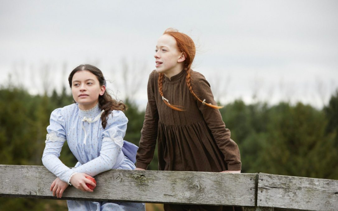 Amybeth McNulty as Anne Shirley and Dalila Bela as Diana Barry in  Anne with an E