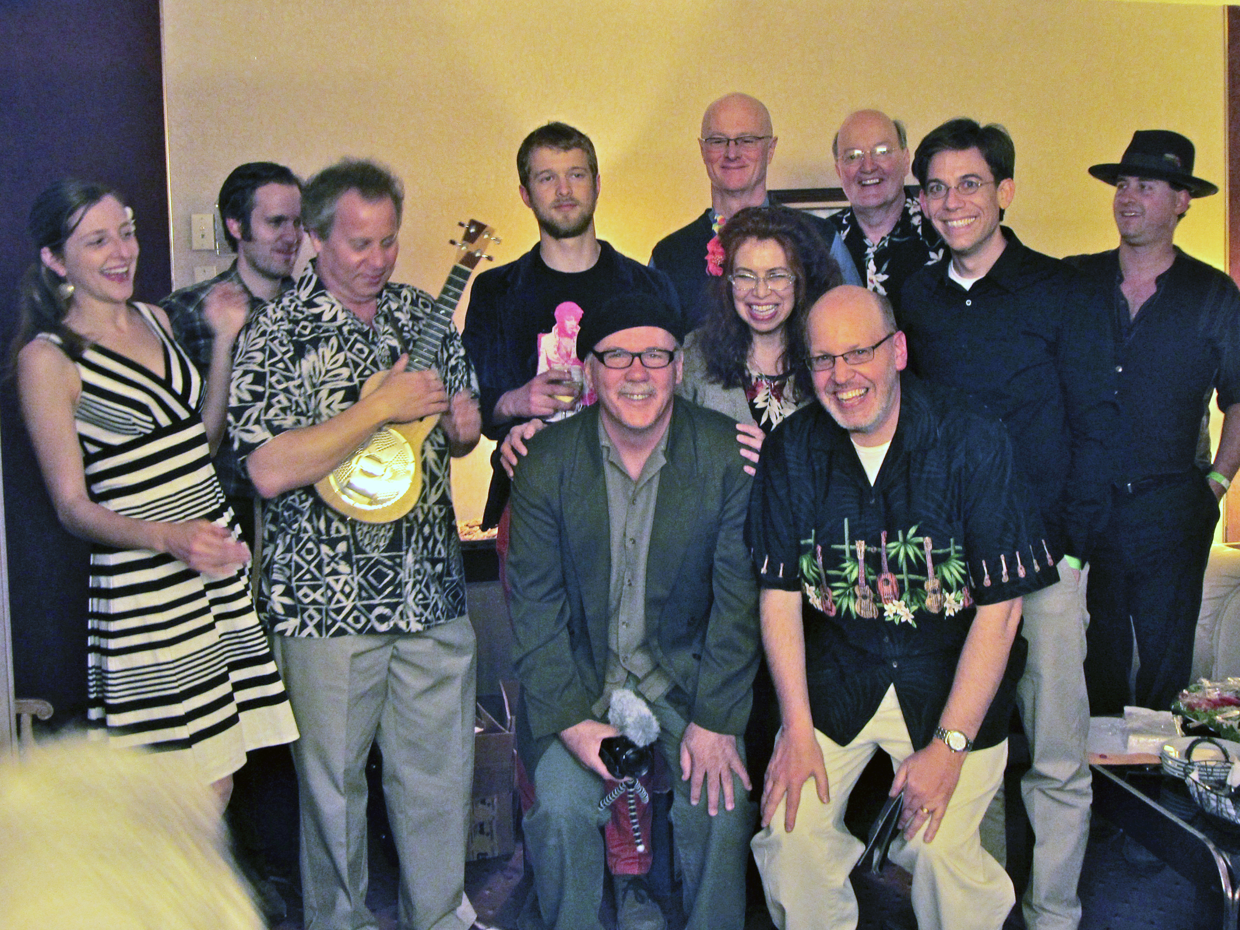 Backstage at the 2012 Reno Ukulele Festival  – (L to R) Sarah Maisel, Aaron Keim, Gerald Ross, Neil  McCormick, Jim D'Ville, Craig Brandau, Cali Rose, Rich Dann, Doug Reynolds, Paul Hemmings, and Lil Rev.