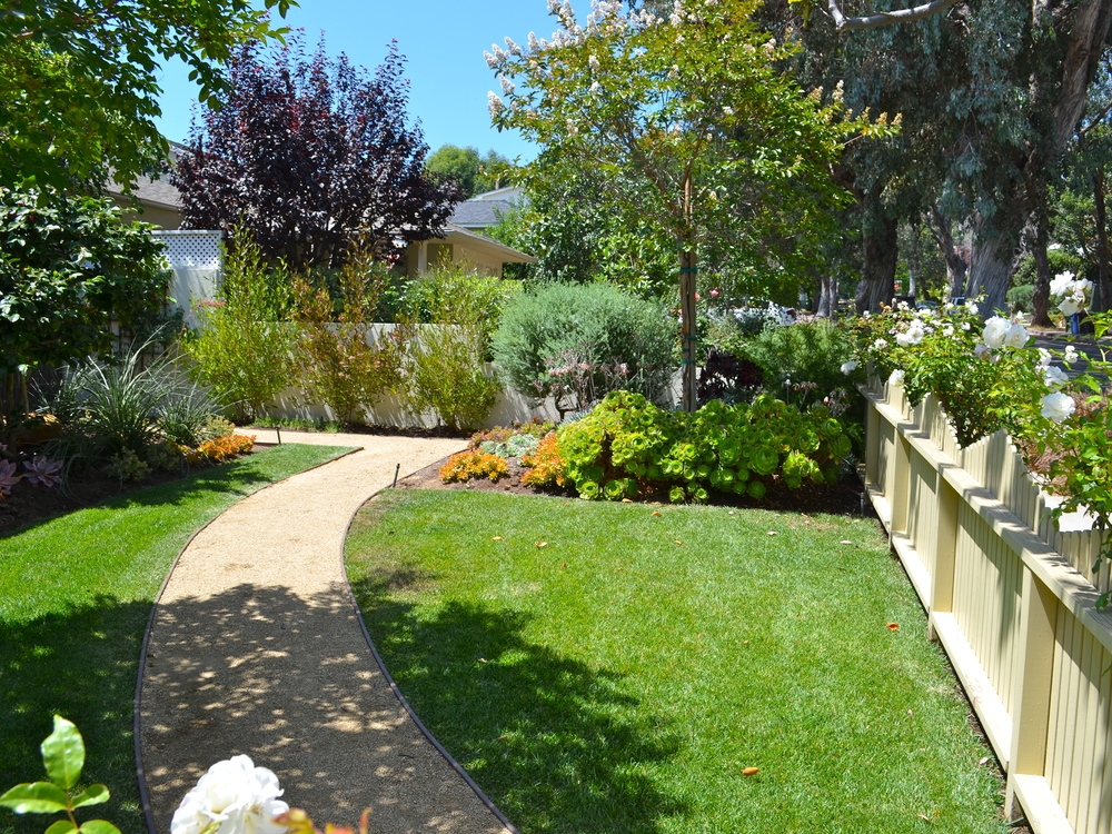 HARTZEL - This original California craftsman bungalow went from only having a plain grass yard to being a charming garden with a picket fence, sweeping pathways, pops of color and flowers and kind friendly play area. We brought this from basic bungalow to charming, classic, and chic.