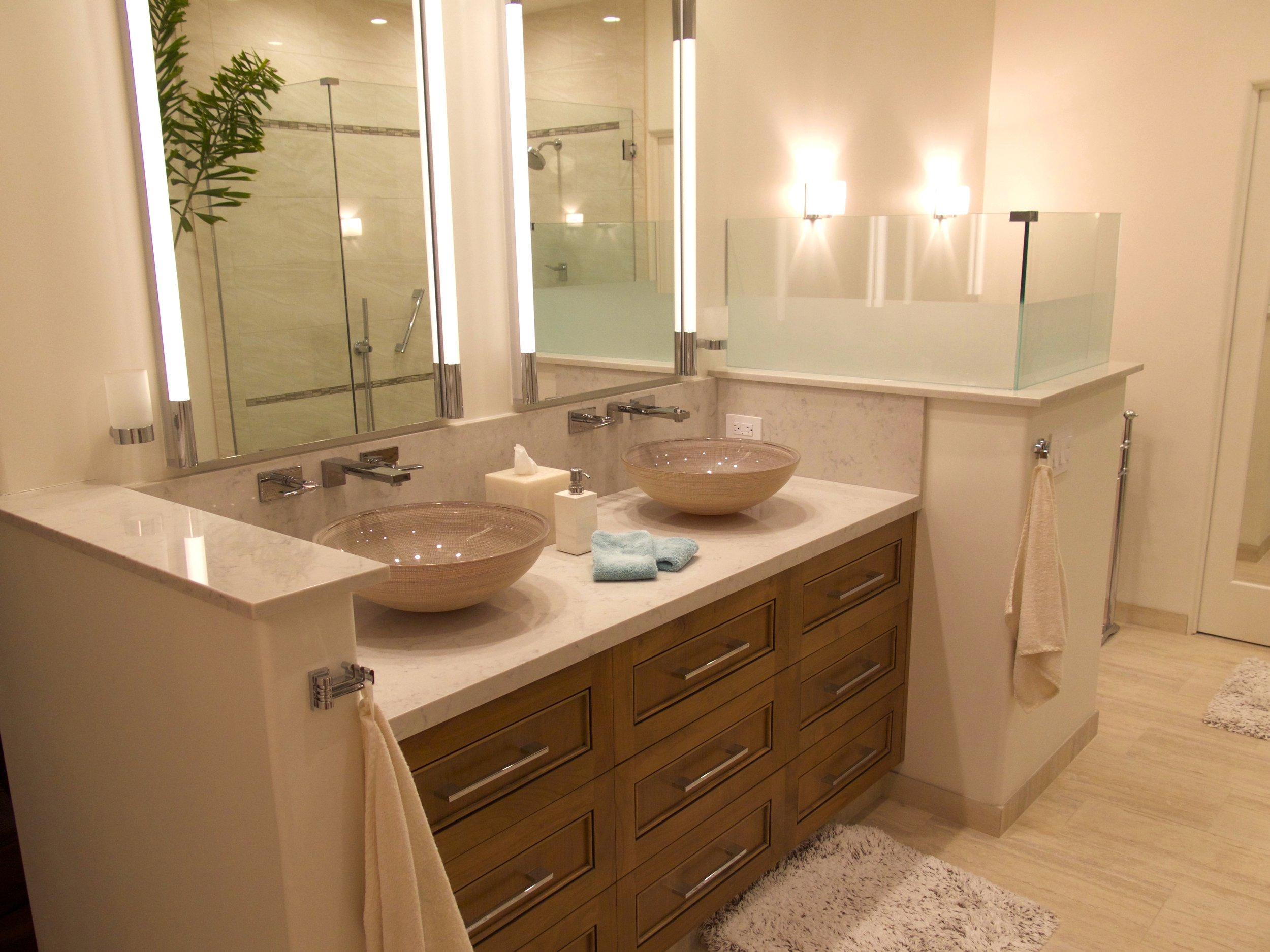 OBSERVATION - In this master bathroom remodel we took the space down to the studs, removed walls, rethought layout and installed all new bright materials. The homeowners wanted a fresh new look that was warm, inviting, and reminiscent of a spa that you wanted to come and relax in.