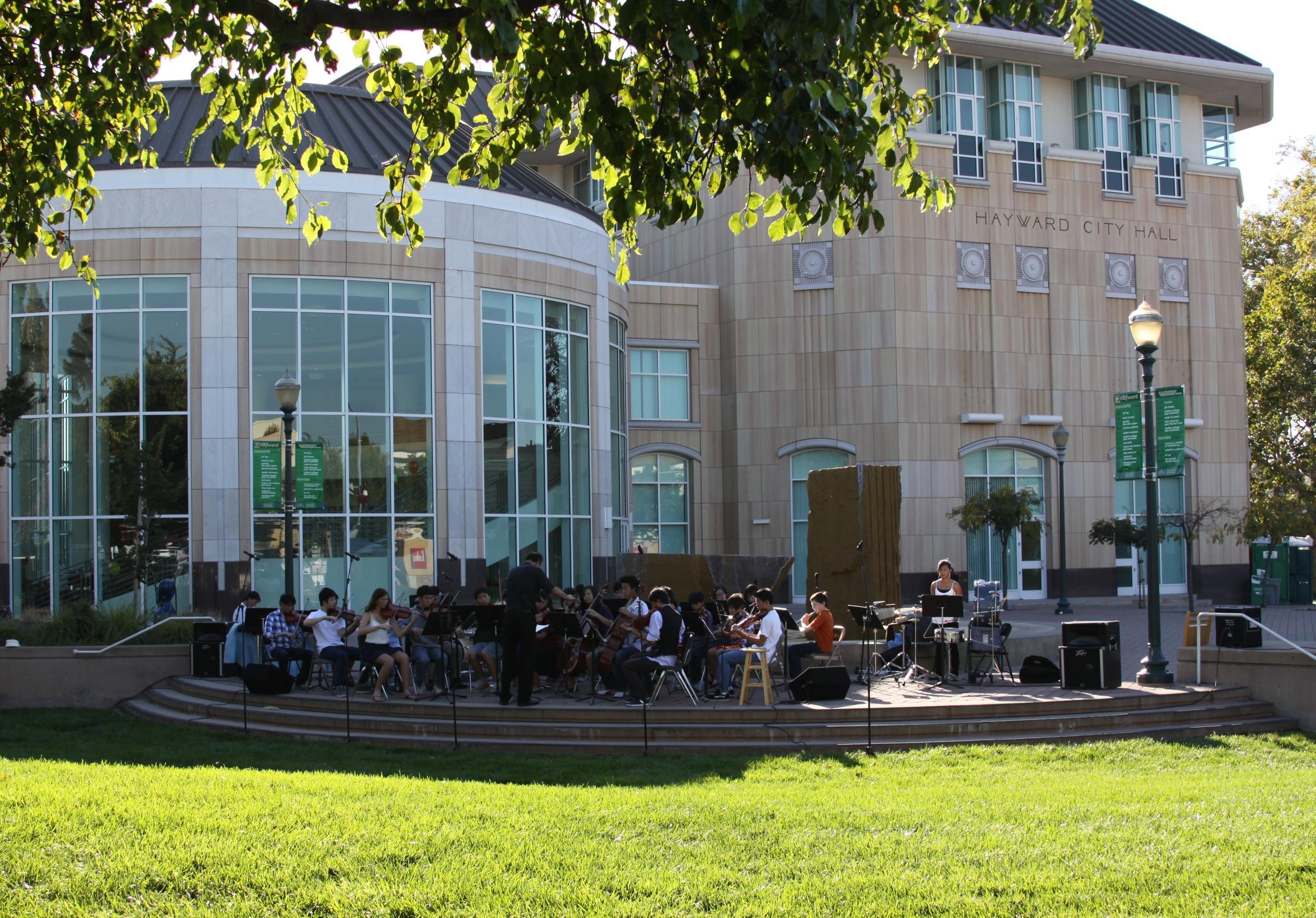 East Bay Youth Orchestra (EBYO) performs outdoors at Hayward City Hall. Hayward, California.