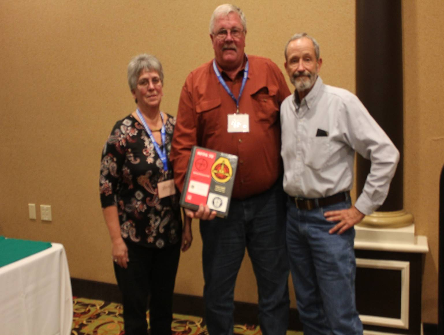 Our Western Section President Dwight Kramer and wife Zoe being presented with the special personalized hard bound National Electrical Code book. From the Nebraska Chapter to you, Thank you!