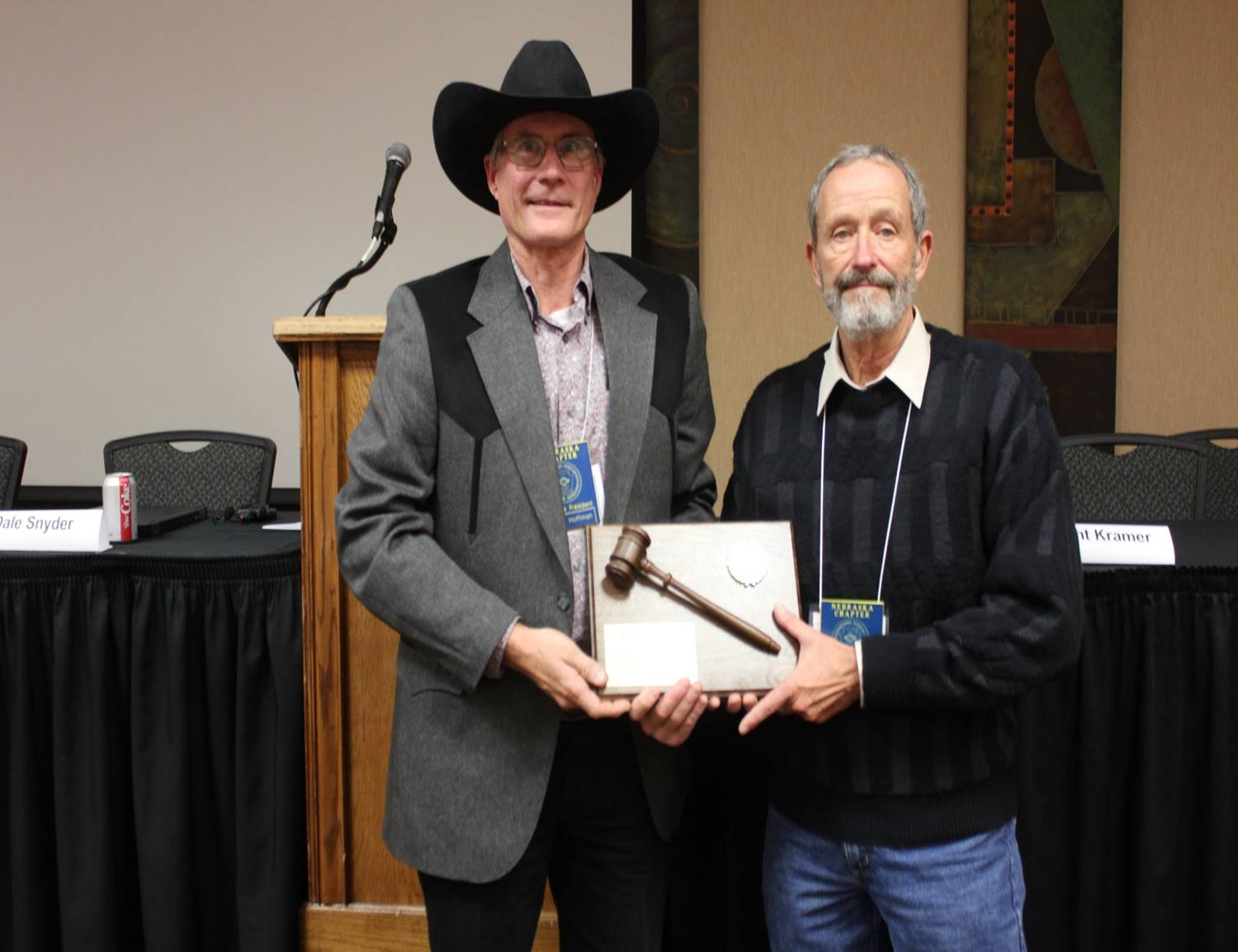 Changing of the guard. New President Bruce Hoffman awarding a thank you plaque to Willie Nelson with a hearty thank you for the leadership over the past year.. Safe travels Willie!