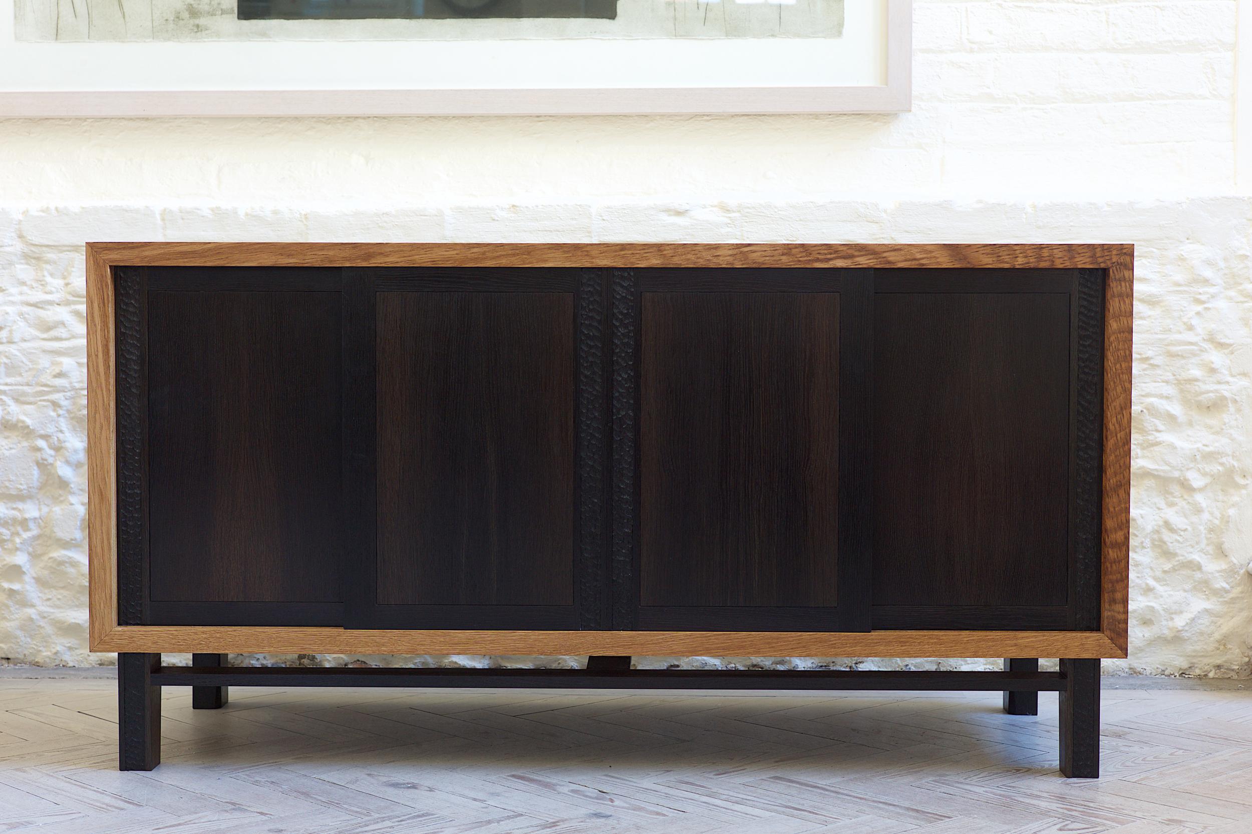 Fine english brown oak sideboard with bog oak doors