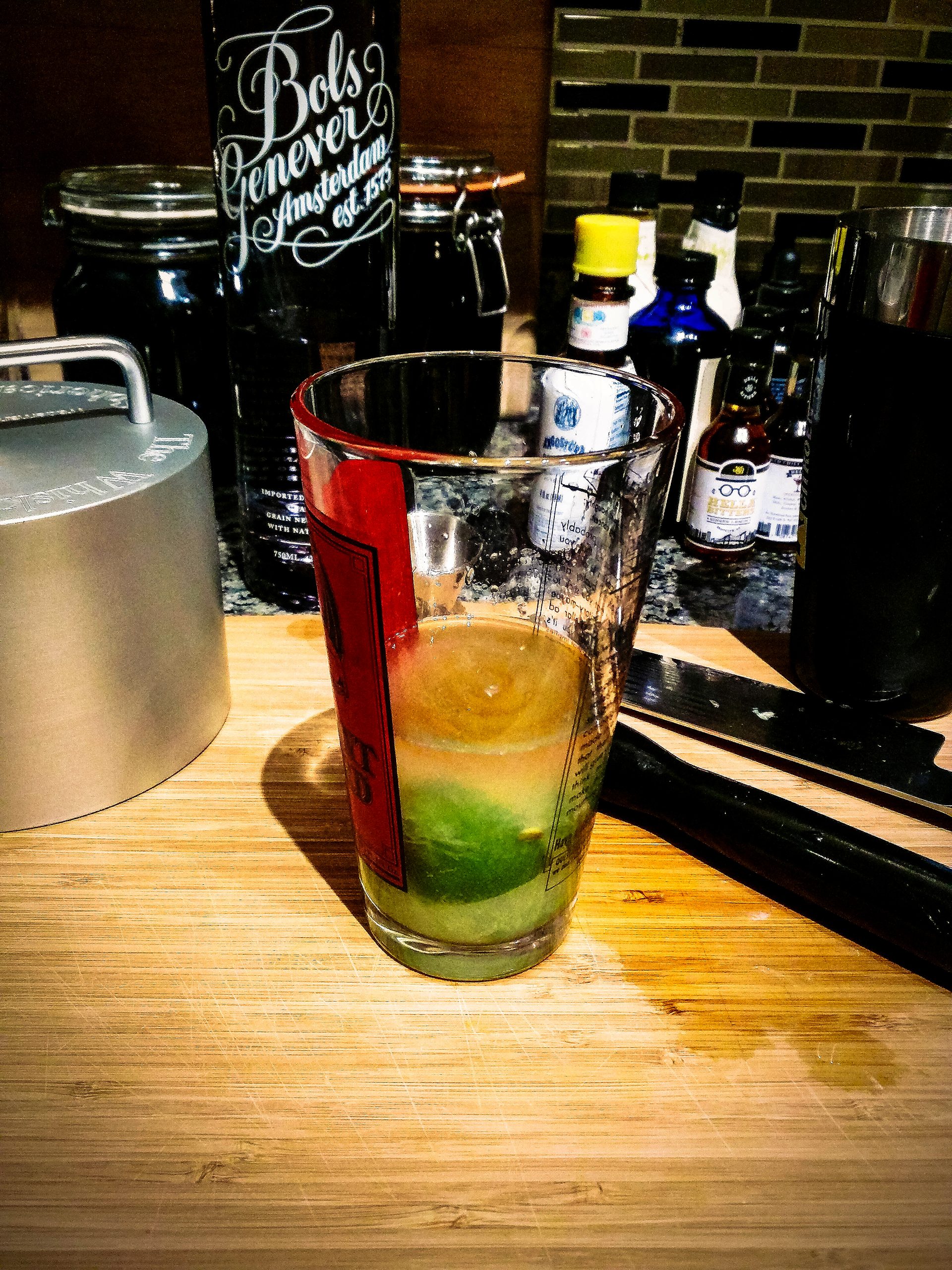 Good and limey, now with four dashes of Angostura bitters.