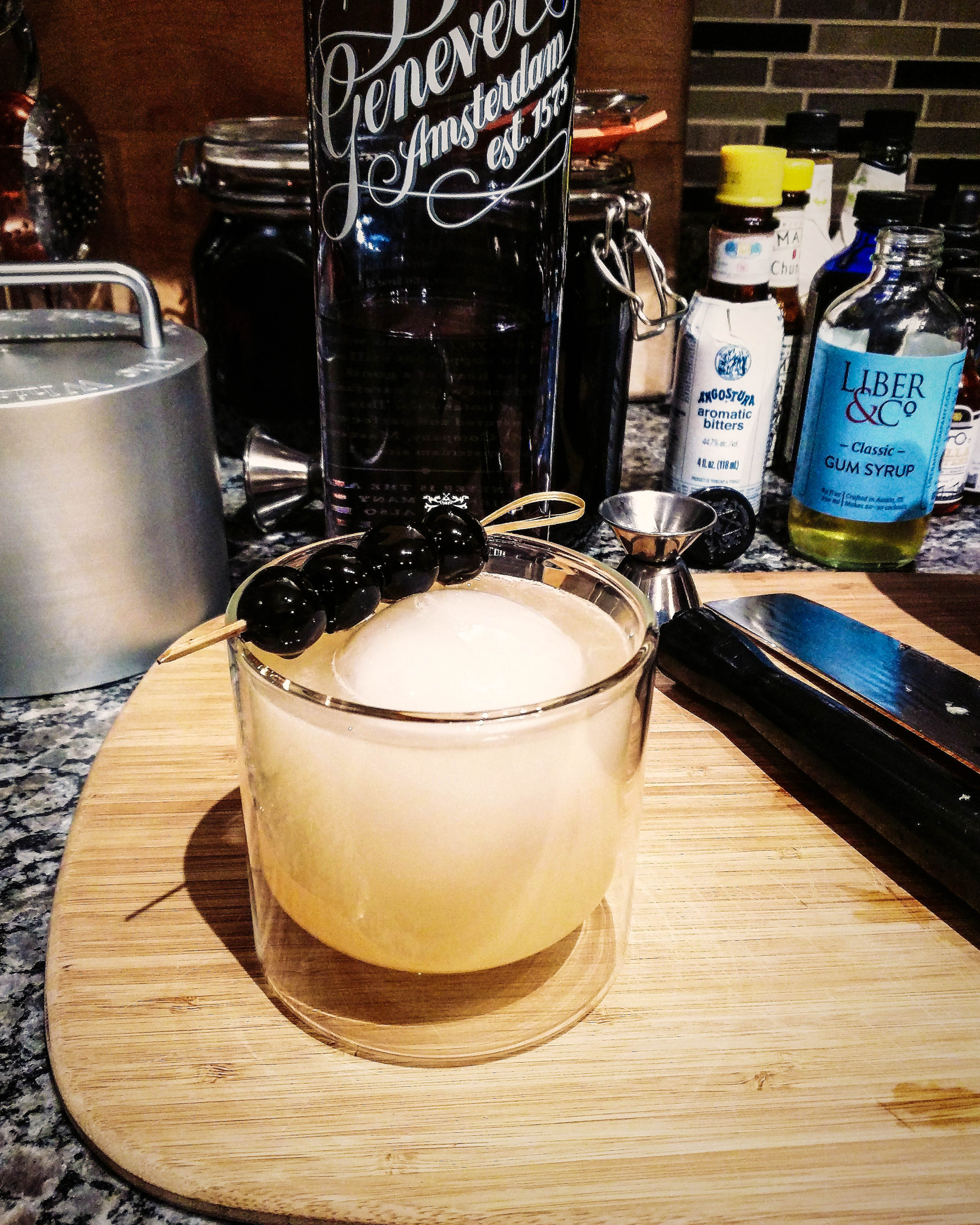 With all ingredients in the shaker, shake with ice for 20-30 seconds. Then strain over your ice ball. Perfect!