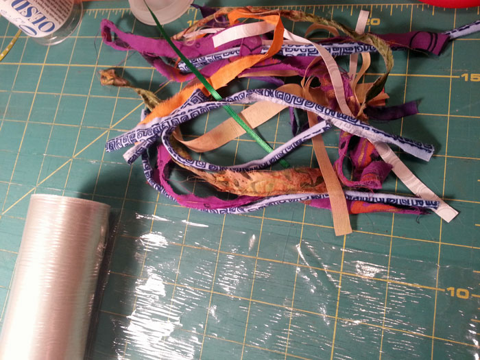 I cut the fabric into strips and laid them out on water soluble stabilizer.