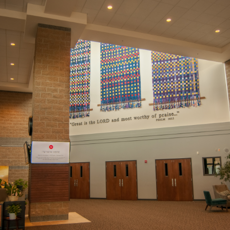The weavings in place in the main lobby above the doors into the sanctuary.