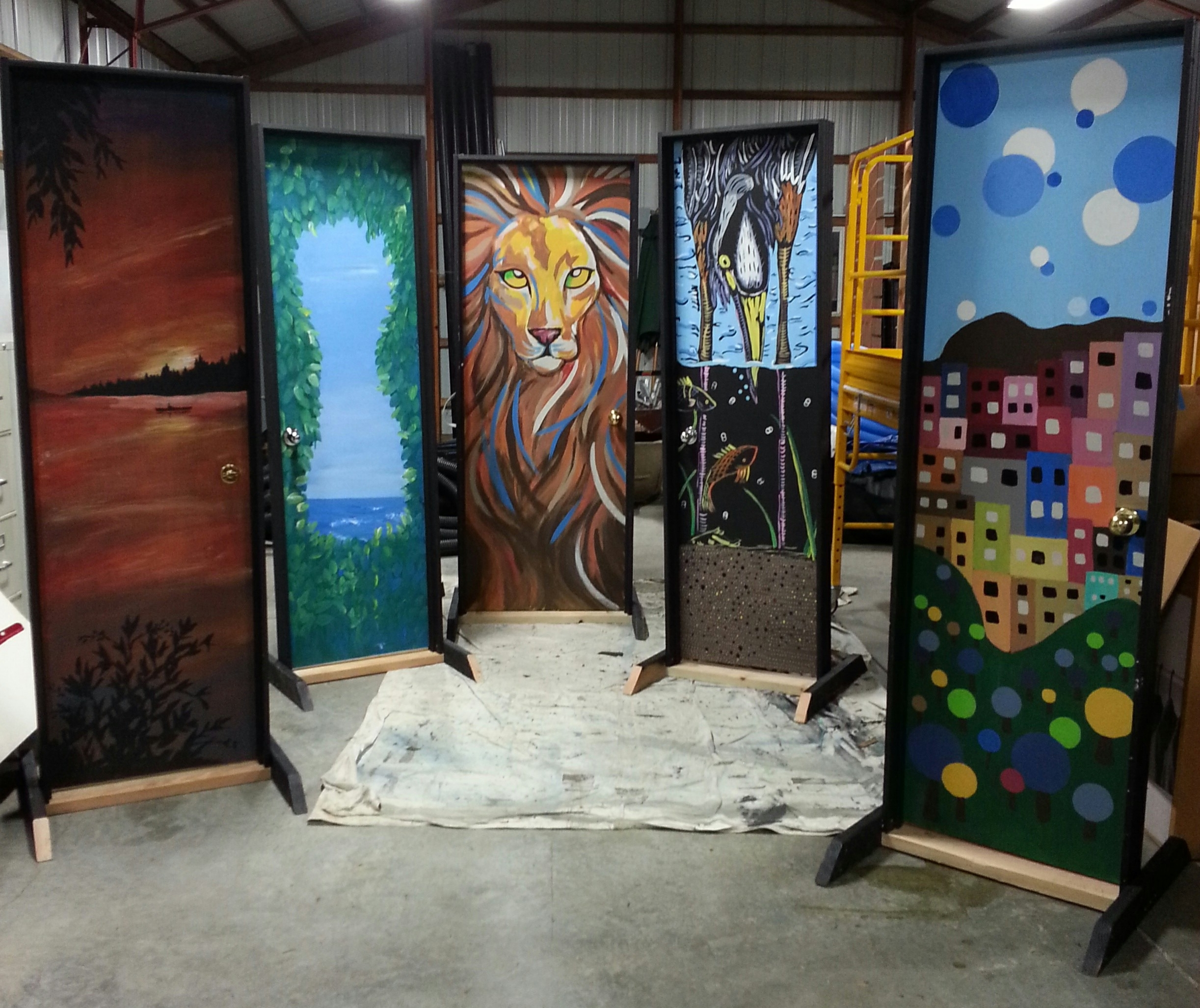 Here  are the five doors. These are the beautiful sides, the other sides were painted solid black. Many thanks to my amazing crew: Veronica Lake, Constance Lee Adams, Kathy Berry, Sue Epps, Gaby Viesca,  and Quynh Nguyen . There is something quite wonderful about painting with friends.